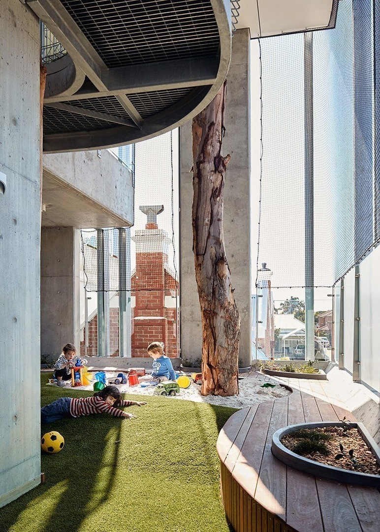 tom godden architects and matthew crawford architects have completed a high-rise childcare center in perth, australia, that differentiates itself from other facilities by focusing on sophisticated, well-thought design.