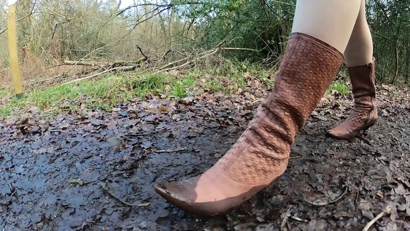 Well worn spike heel stiletto boots being abused on the road in mud and dunked in water.