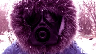 Winter walks in a navy blue winter ski snow suit and different respirators and gas masks
