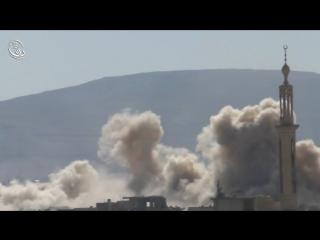 Сирия.Вертолёт ВВС САР наносит бомбовый удар по позициям боевиков в Дарайе,мухафаза Дамаск. .