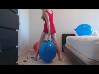 Girl sit to pop big balloons