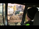 Moving Gravel and Loading Hydrema Dumper With An Komatsu PC210 Excavator