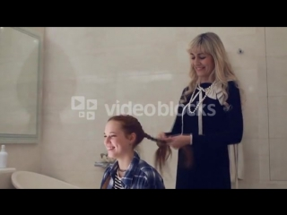 Videoblocks-mother-making-braids-on-her-daughters-head_s9qqg_dje__pm (1).mp4