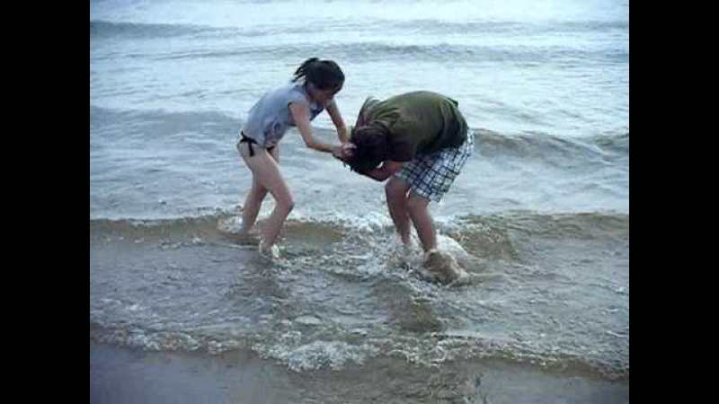 Cindy and Spencer (mom and Son) Wrestling in Lake Michigan, Ludington.