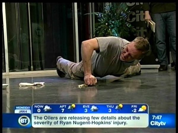 Darryl Learie on TV for Most One Arm Push ups on a Raw Egg and RecordSetter Book