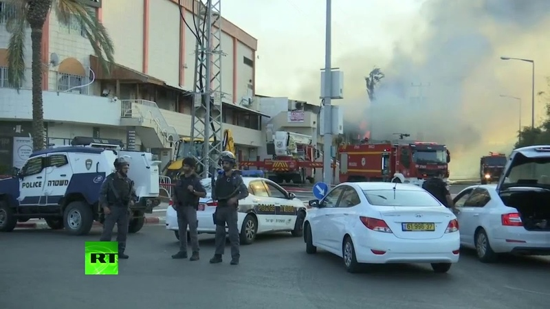 Gaza-fired rocket hits a factory building and ignites fire in Israel