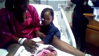 Breastfeeding toddler meets breastfeeding newborn sister for the 1st time