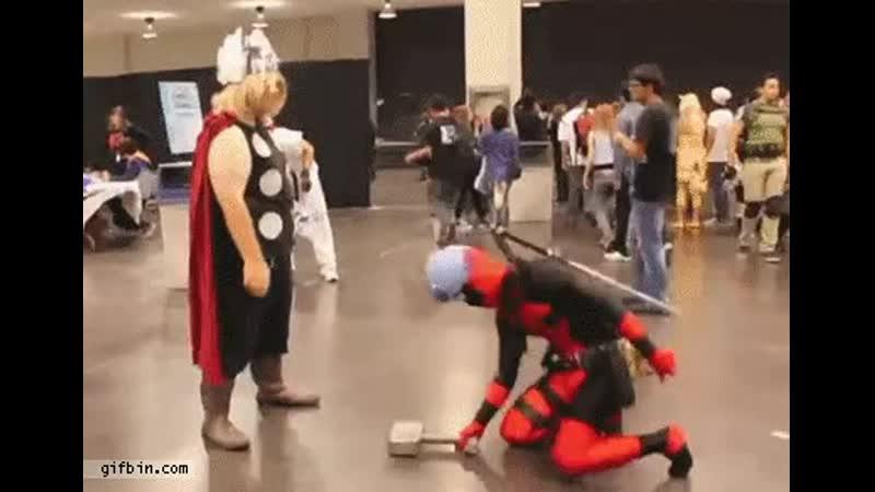 Deadpool tries Thor 's hammer