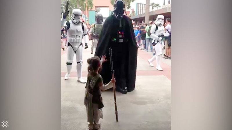 Four-year-old girl dressed as Rey meets Star Wars characters