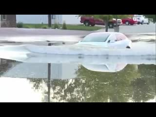 Now i know what my future car is.  a tesla model x in mitchell drives down a flooded street as colton molesky reports live.